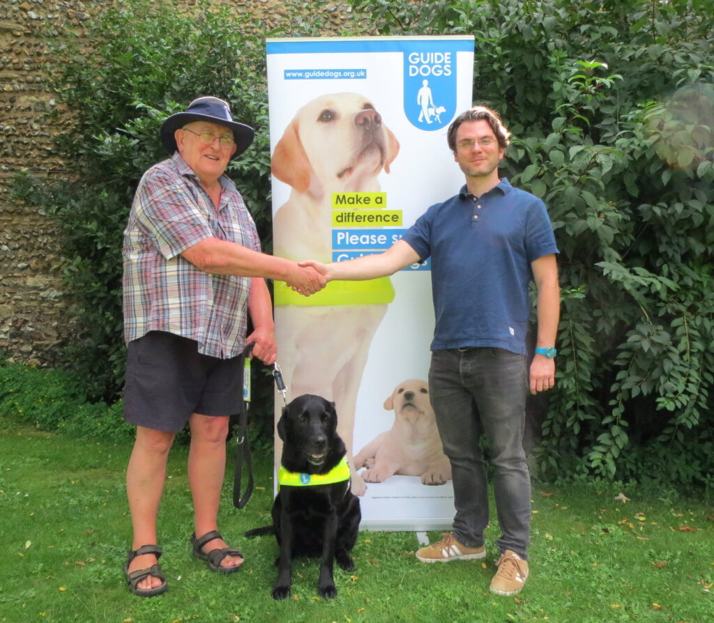 VivaVoices cheque presentation for Guide Dogs charity.